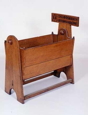 10: AN UNUSUAL MISSION OAK INFANT CRADLE, English, c. 1