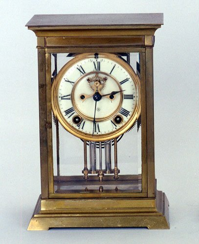 6: AN ANSONIA BRASS CASED MANTLE CLOCK with beveled gla