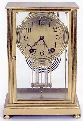 9: SETH THOMAS SHELF CLOCK, brass cased with beveled gl