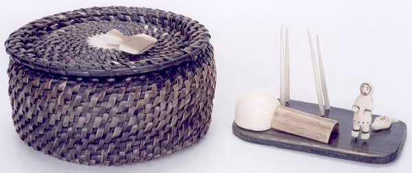 15: TWO INNUIT HAND MADE PIECES: a woven basket made fr