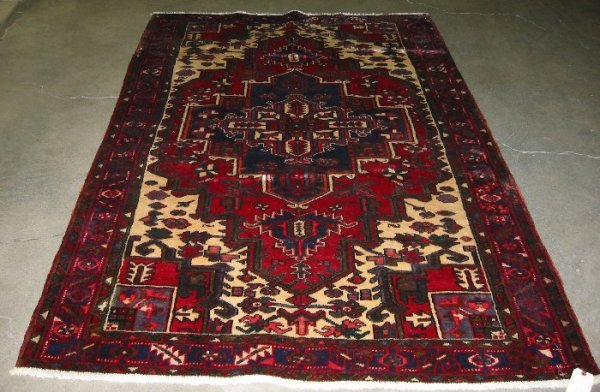 11: PERSIAN HEREZ AREA RUG, centering a blue geometric