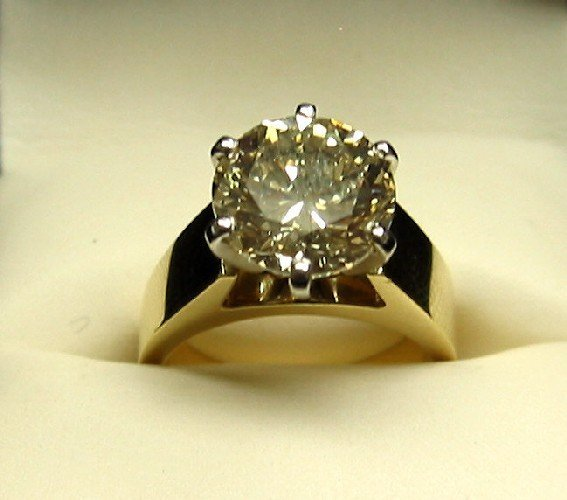 197: DIAMOND AND FOURTEEN KARAT GOLD SOLITAIRE RING. A