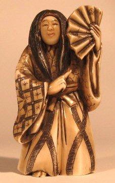 "4: A JAPANESE IVORY ""TRICK"" FIGURE, hand carved, a mode"