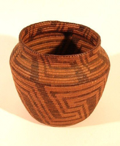 12: A NAVAJO-PAIUTE INDIAN BASKET in traditional zigzag