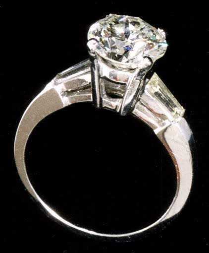 123: DIAMOND AND FOURTEEN KARAT WHITE GOLD SOLITAIRE RI