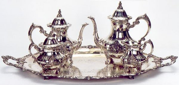 5: AN AMERICAN SILVER PLATED FIVE PIECE TEA AND COFFEE
