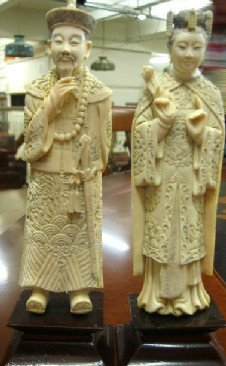 12: A PAIR OF IVORY FIGURES depicting the Chinese emper