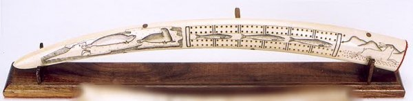 15: A WALRUS IVORY TUSK scrimshaw decorated by an Innui