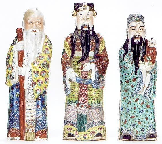 871: THREE CHINESE POTTERY FIGURES OF WISE MEN: one hol