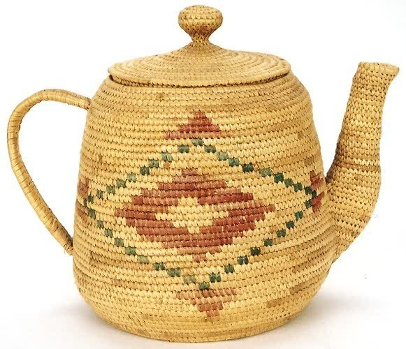 8: AN INNUIT INDIAN COVERED BASKET in the form of a tea