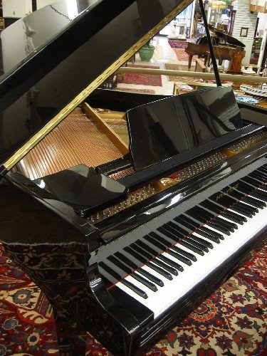 786: HYUNDAI BABY GRAND PIANO WITH BENCH, model G-50A,