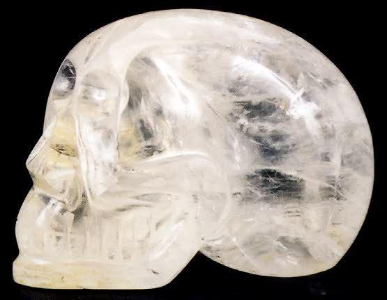 806: A NATURAL ROCK CRYSTAL SCULPTURE of a human skull.