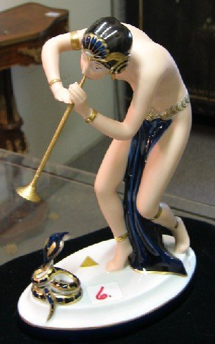 6: ROYAL DUX PORCELAIN FIGURINE, an art deco figure of