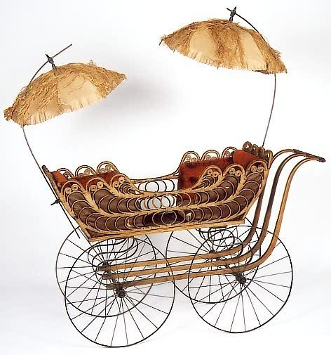 18: RATTAN AND WOOD TWO-SEAT STROLLER, attributed to th
