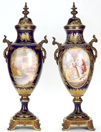 817: PAIR FRENCH SEVRES PORCELAIN COVERED URNS. The cob