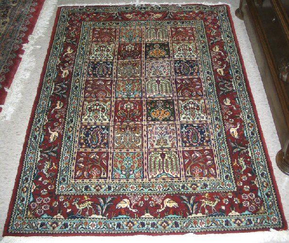 235: PERSIAN BIRJAND GARDEN AREA RUG. Framed within a r