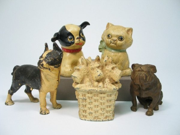 908: FIVE PAINTED AND DECORATED IRON ANIMAL BANKS: a ba