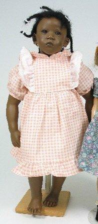 917: AN ANNETTE HIMSTEDT BLACK PORCELAIN GIRL DOLL, in