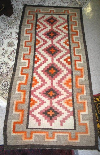 7: NAVAJO WOOL AREA RUG, hand woven and patterned with