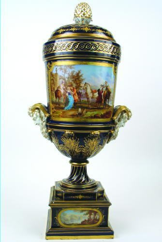 799: SEVRES PORCELAIN COVERED URN. The cobalt blue fiel