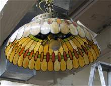59: AN ART DECO STAINED AND LEADED GLASS HANGING LAMP c