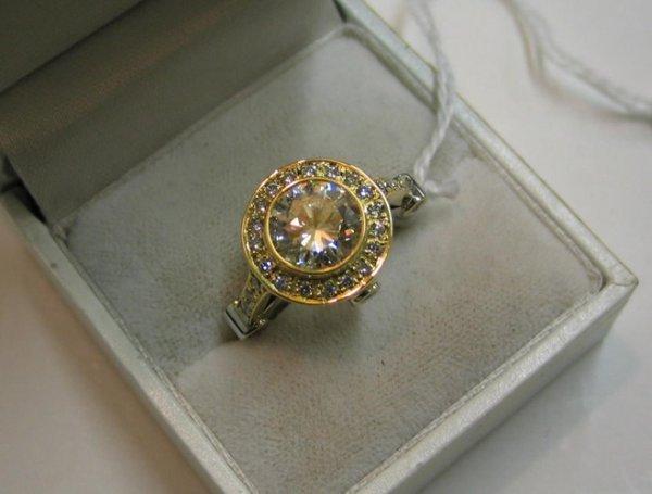 678: DIAMOND AND EIGHTEEN KARAT WHITE AND YELLOW GOLD R