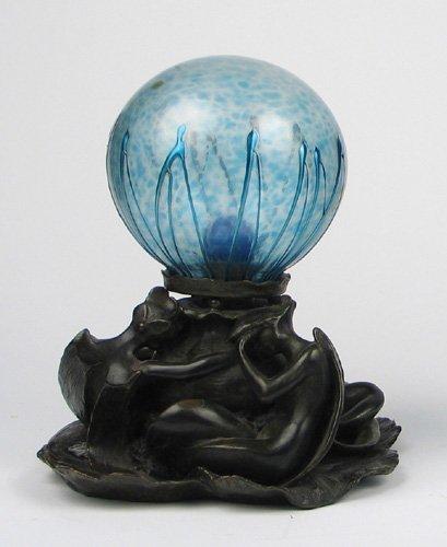9: A FRENCH ART NOUVEAU BRONZE ART GLASS LAMP, having t