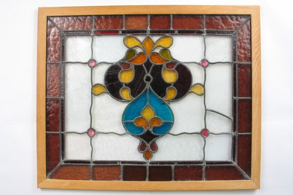 4: AN AMERICAN STAINED AND LEADED GLASS WINDOW PANEL, w