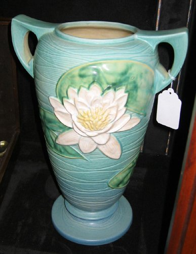 21: AMERICAN WELLER POTTERY TWIN-HANDLED VASE in the ra
