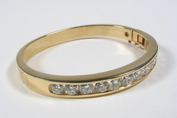 797: DIAMOND AND FOURTEEN KARAT GOLD BANGLE WITH APPRAI