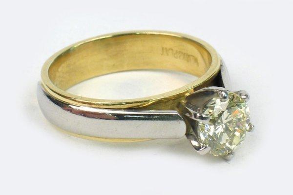 759: DIAMOND, PLATINUM AND EIGHTEEN KARAT GOLD SOLITAIR