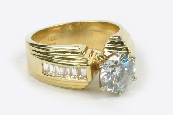 795: DIAMOND AND FOURTEEN KARAT GOLD RING. Centered and