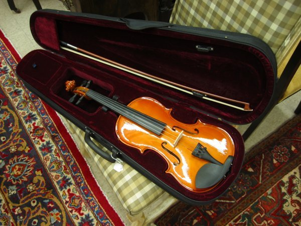 5: A HAND MADE VIOLIN from hard wood with original bow.