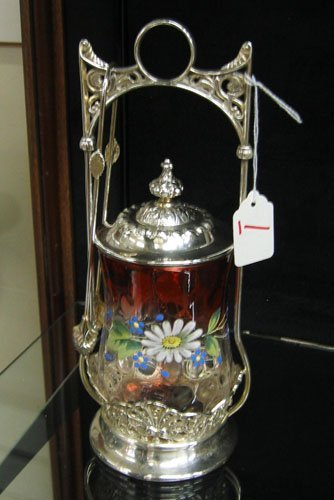 1: AN AMERICAN SILVERPLATED PICKLE CASTER, with enamele