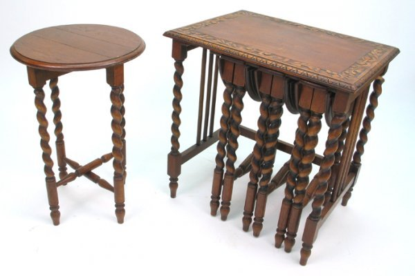 10: AN UNUSUAL SET OF FIVE CARVED OAK OCCASIONAL TABLES