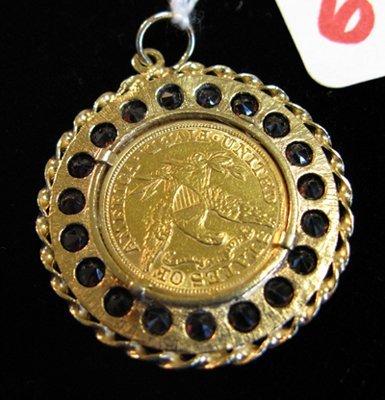 6: U.S. GOLD COIN, GARNET AND FOURTEEN KARAT GOLD