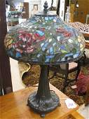 241: A PETITE STAINED AND LEADED GLASS TABLE LAMP, the