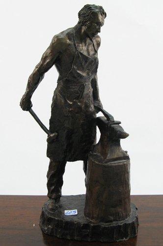 603: SOLID BRONZE FIGURE depicting a blacksmith  workin