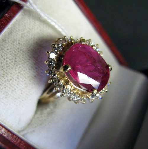 625: RUBY, DIAMOND AND FOURTEEN KARAT GOLD RING WITH  A