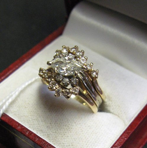 626: DIAMOND AND FOURTEEN KARAT GOLD WEDDING SET WITH A
