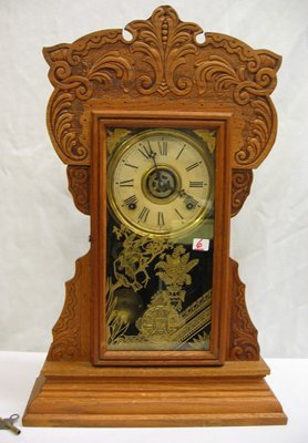 6: AN AMERICAN CARVED OAK KITCHEN CLOCK, by the Wm. L.