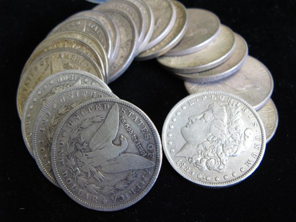 17: A ROLL OF NINETEEN U.S. SILVER DOLLARS.  The lot in