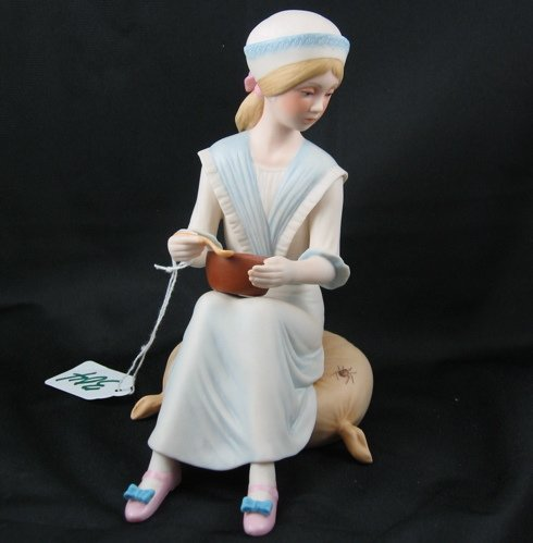 "304: CYBIS PORCELAIN FIGURINE, ""Miss Muffet"", seated  i"