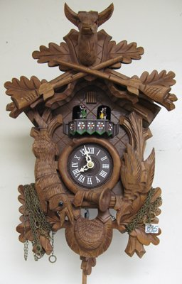 305: A GERMAN BLACK FOREST CARVED WOOD CUCKOO CLOCK