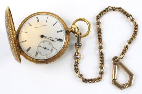 609: AN ENAMELED EIGHTEEN KARAT GOLD HUNTER CASE  POCKE