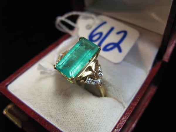 612: EMERALD, DIAMOND AND FOURTEEN KARAT GOLD RING,  ce