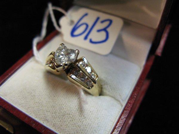 613: DIAMOND AND FOURTEEN KARAT GOLD RING, centering  a