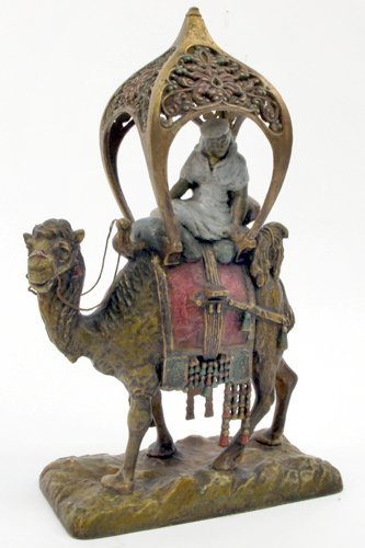 11: A COLD-PAINTED SPELTER FIGURE. An Arab in  traditio
