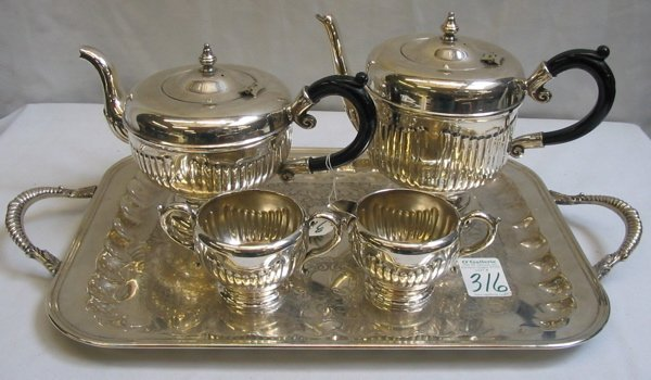 316: A ENGLISH STYLE FOUR PIECE SILVERPLATED TEA SET,