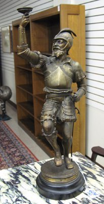 604: PAIR GERMAN SPELTER FIGURES: an armored soldier  r